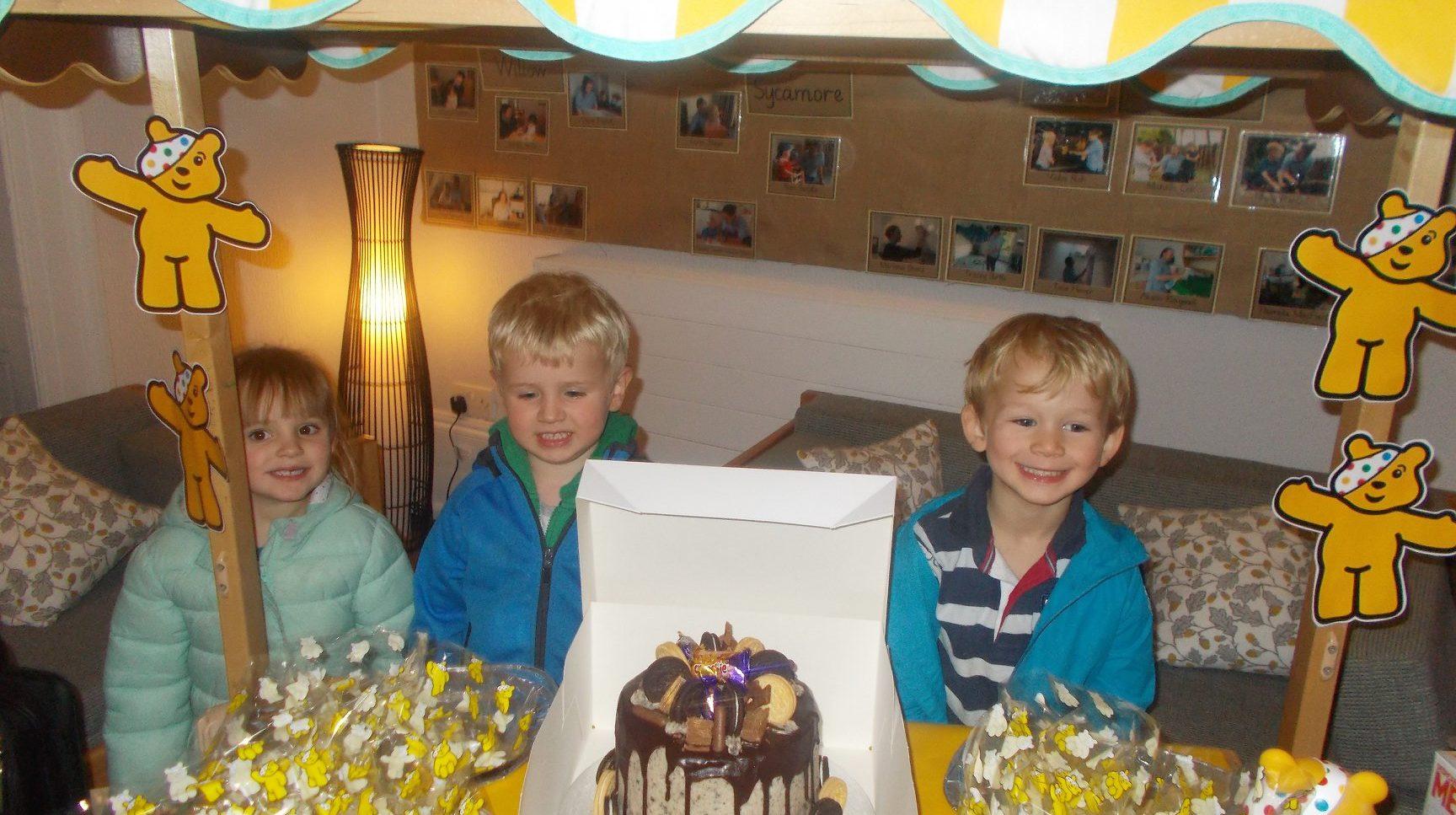Childern selling cakes
