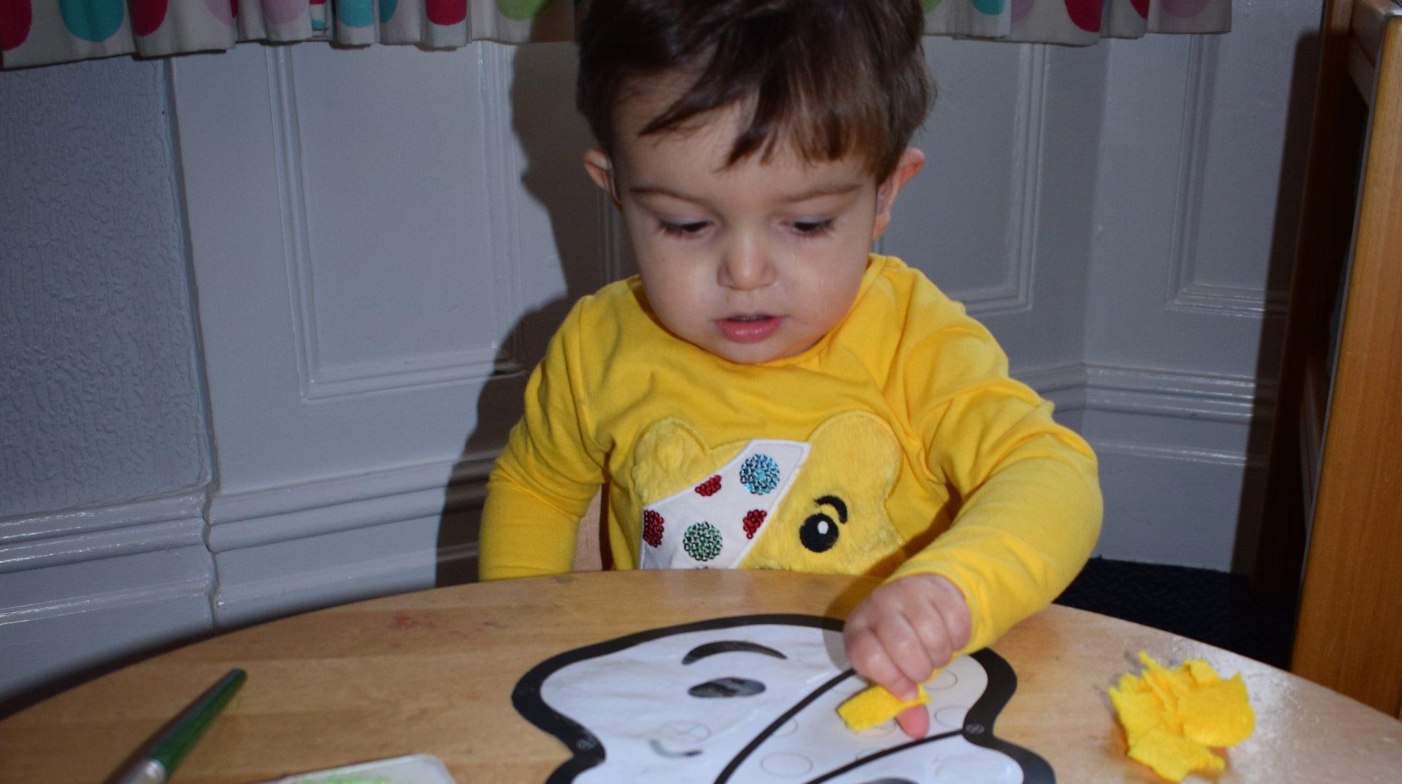 Painting Pudsey bears in nursery