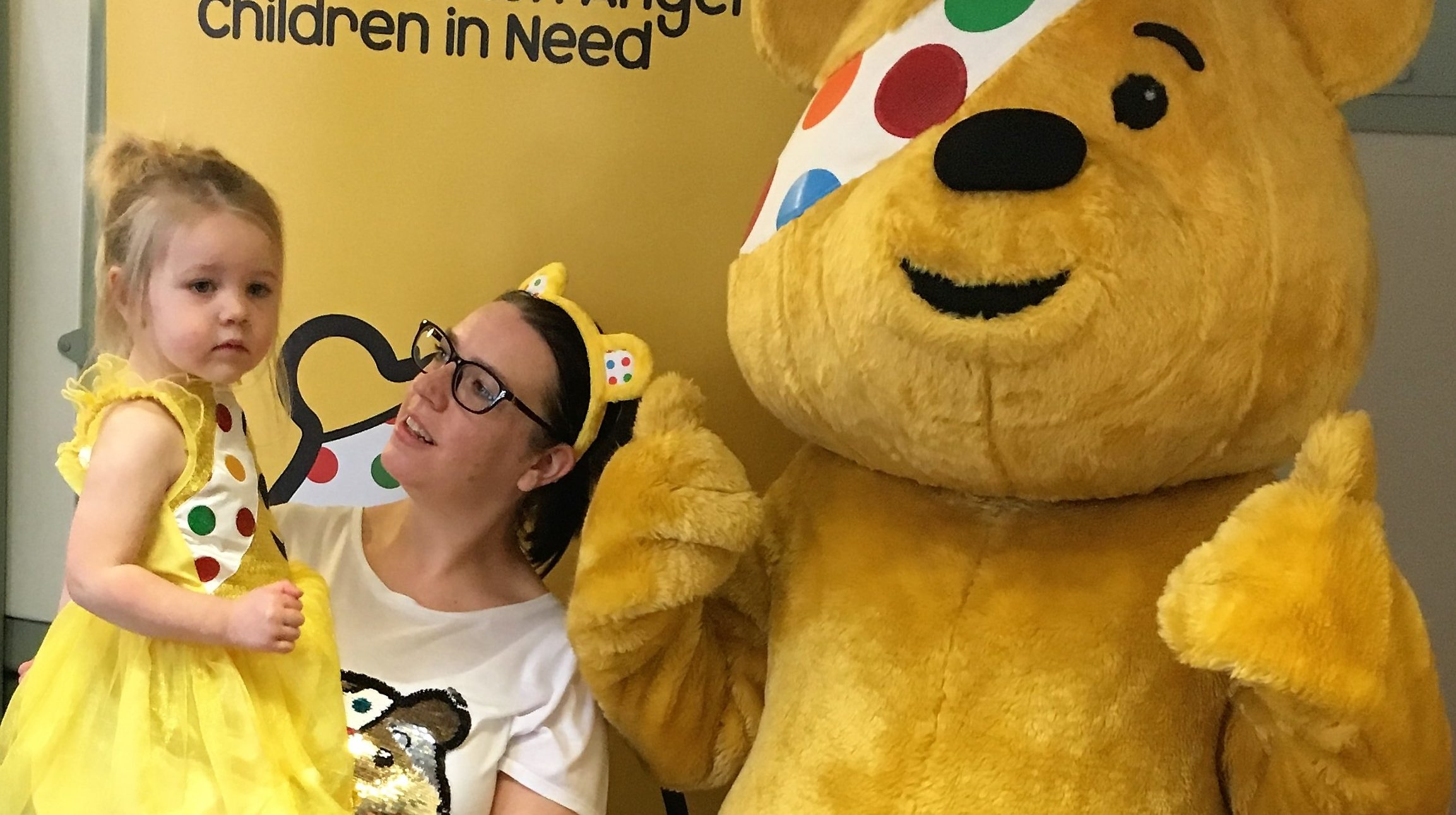 Child with Pudsey Bear